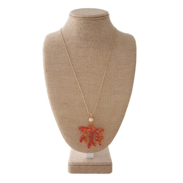 "Gold tone adjustable necklace with an acetate coral pendant. Approximately 30"" in length."