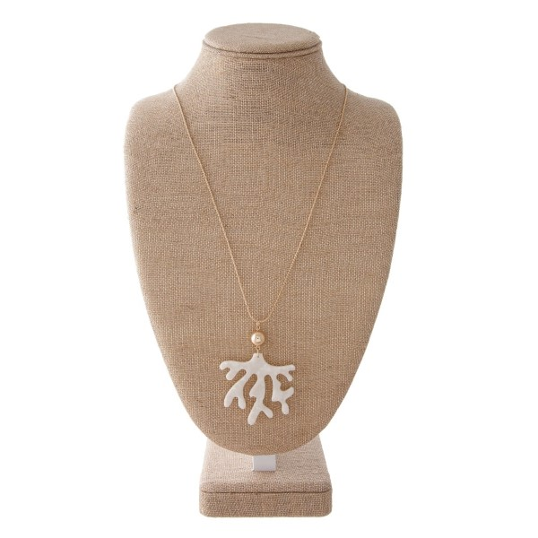 """Gold tone adjustable necklace with an acetate coral pendant. Approximately 30"""" in length."""