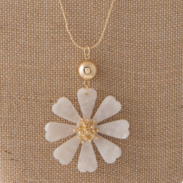 """Gold tone adjustable necklace with acetate flower pendant. Approximately 28"""" in length."""