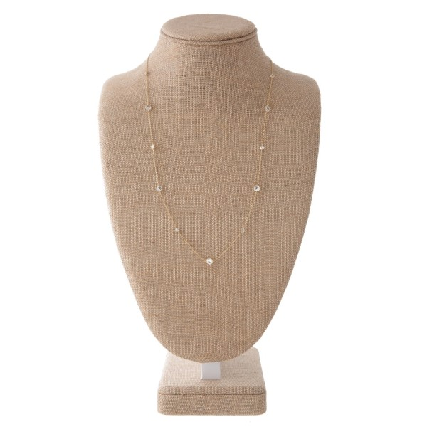 """Dainty metal necklace with CZ details. Approximately 24"""" in length."""