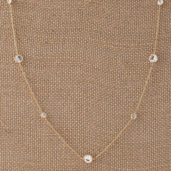 "Dainty metal necklace with CZ details. Approximately 24"" in length."