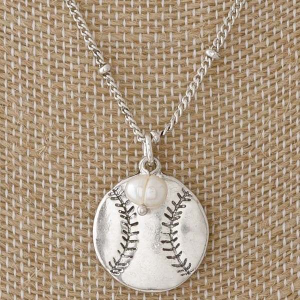 """Short metal necklace with baseball pendant and pearl detail. Approximately 16"""" in length."""
