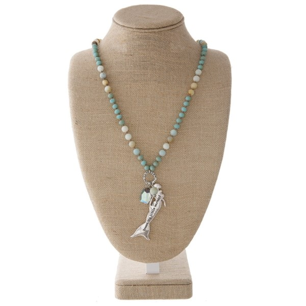 "Long necklace with faceted and natural stone beads and a mermaid pendant. Approximately 32"" in length with a 2"" pendant."