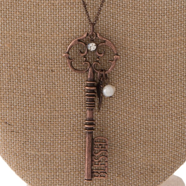 """Long necklace with key pendant with Blessed cutout. Approximately 30"""" in length with a 3"""" pendant."""
