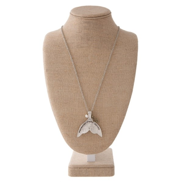 "Long silver tone necklace with sea life charm, pearl accent, and mermaid tail stamped with Mermaids Make Waves. Approximately 30"" in length with a 2.5"" pendant."
