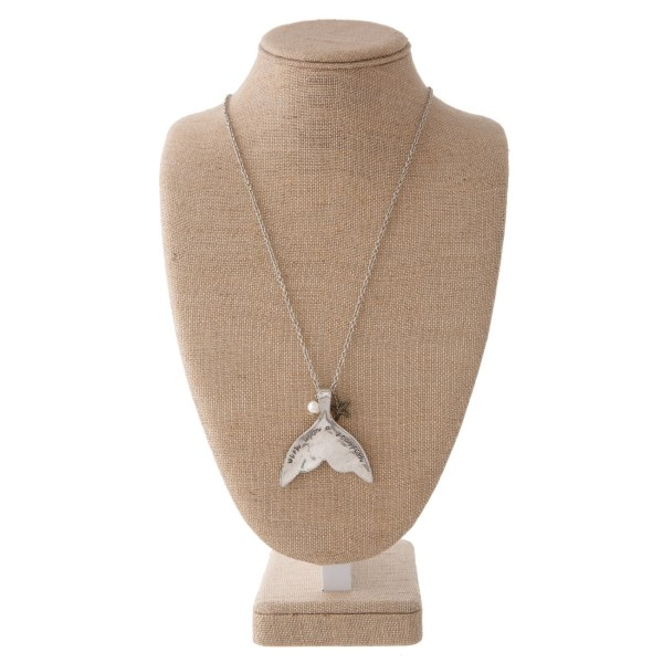 "Long silver tone necklace with sea life charm, pearl accent, and mermaid tail stamped with Wish Upon a Starfish. Approximately 30"" in length with a 2.5"" pendant."