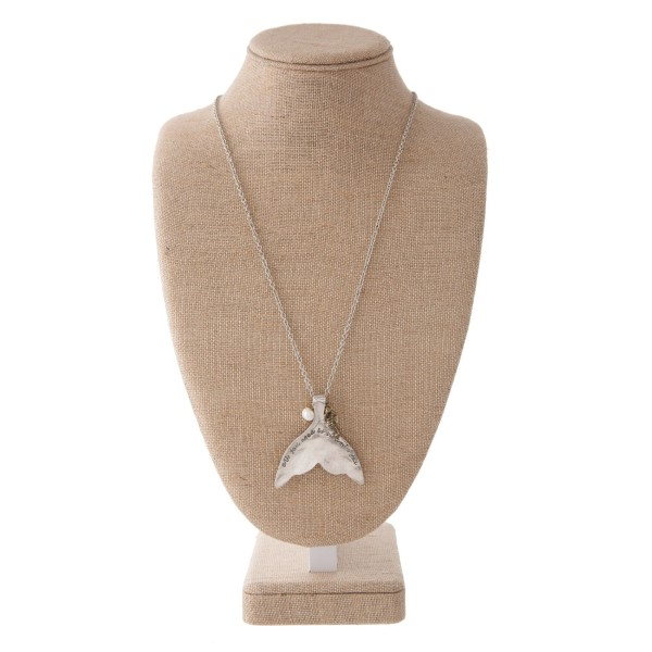 "Long silver tone necklace with sea life charm, pearl accent, and mermaid tail stamped with All you Need is Vitamin Sea. Approximately 30"" in length with a 2.5"" pendant."