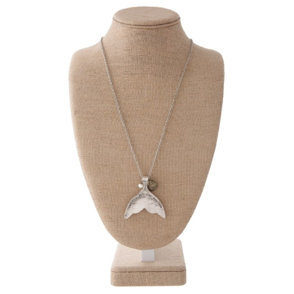 "Long silver tone necklace with sea life charm, pearl accent, and mermaid tail stamped with Let the Sea set you Free. Approximately 30"" in length with a 2.5"" pendant."