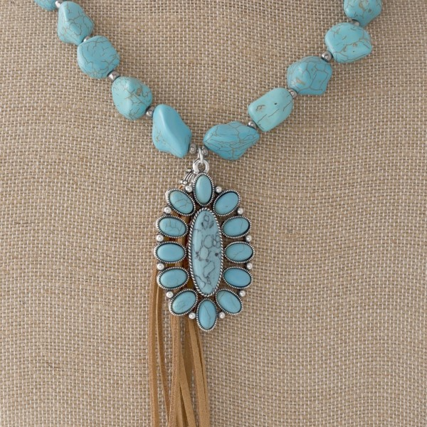 """Long necklace with natural stone beads, wester pendant, and leather tassel. Approximately 30"""" in length. with a 4"""" tassel."""