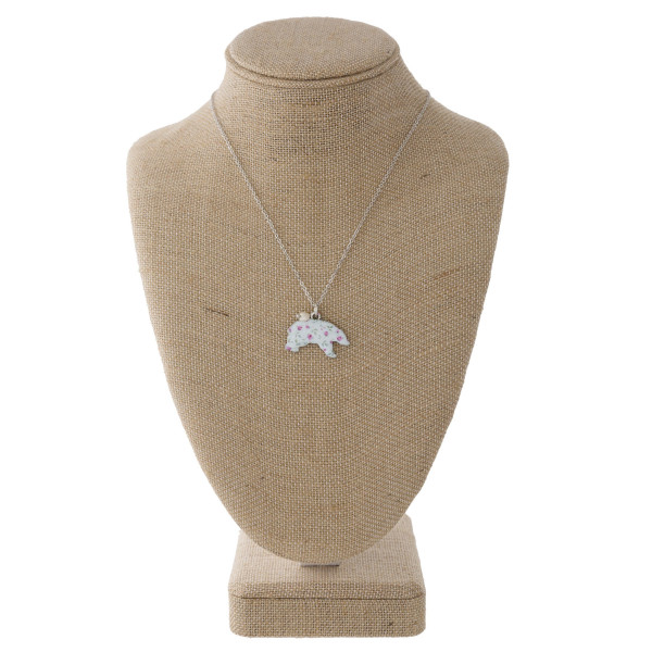 """Short necklace with a floral metal bear pendant. Approximately 16"""" in length with a 1.5"""" pendant."""
