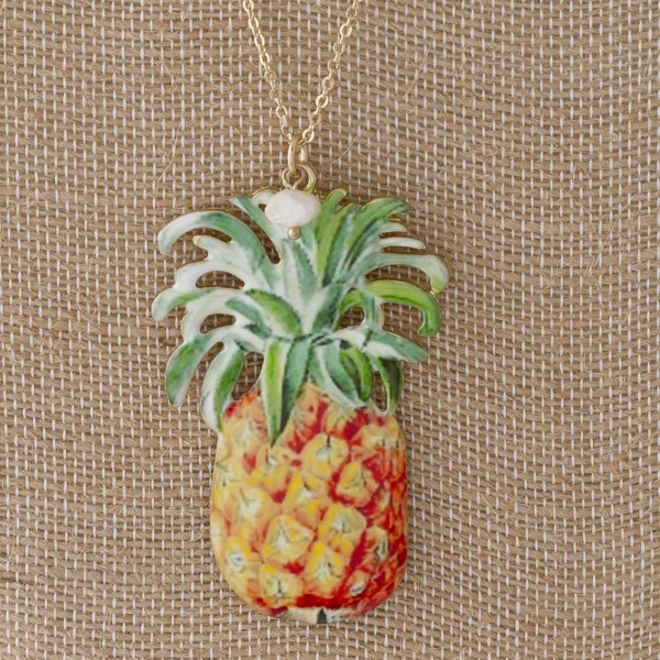 "Metal necklace with a tropical pendant. Approximately 18"" in length with a 2"" pendant."