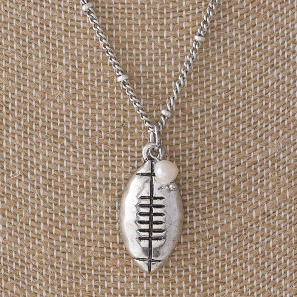"""Short metal necklace with football charm. Approximately 16"""" in length."""