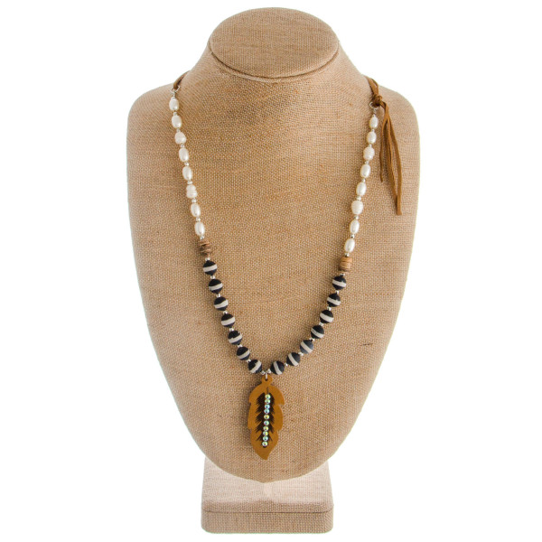 "Long layered necklace with pearls, rhinestones and wood details. Attached feather pendant.  Approximate 30"" in length with 2"" pendant."