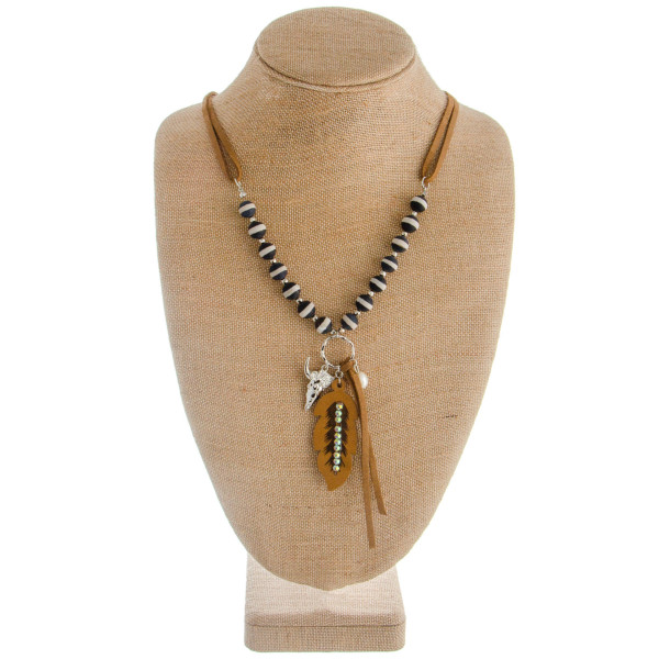 "Long layered necklace with pearls, rhinestones and wood details. Attached feather/deer pendant.  Approximate 30"" in length with 2"" pendant."