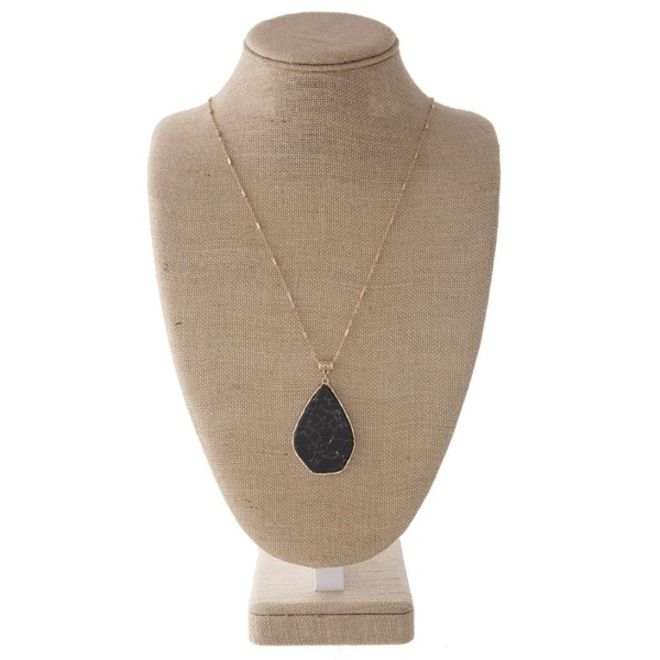 """Gold tone necklace with oval natural stone pendant. Approximately 32"""" in length with a 2.5"""" stone."""