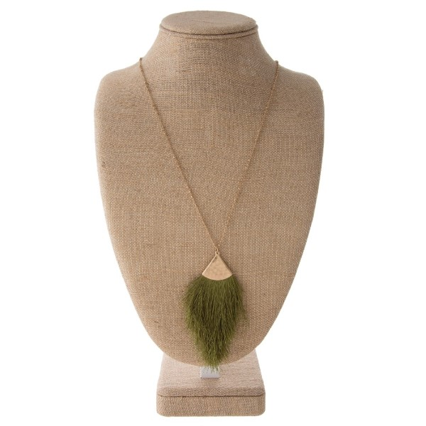 """Long gold metal necklace featuring a olive tassel pendant. Pendant approximately 4"""". Approximately 38"""" in length overall."""