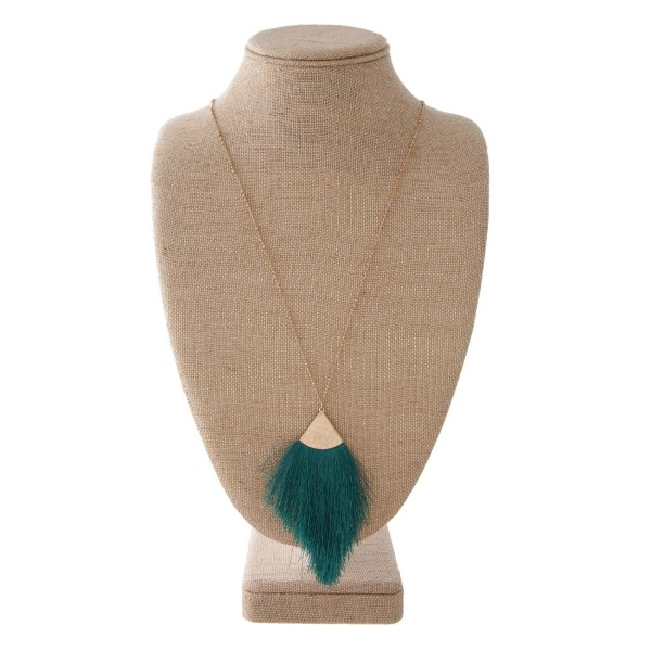 "Long satellite chain necklace featuring a tassel pendant. Pendant approximately 4"". Approximately 38"" in length overall."