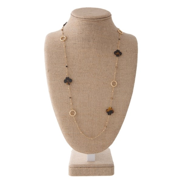 """Long gold tone necklace with acetate clover details. Approximately 28"""" in length."""