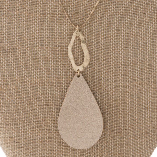 "Long gold tone necklace with faux leather teardrop pendant. Approximately 30"" in length."
