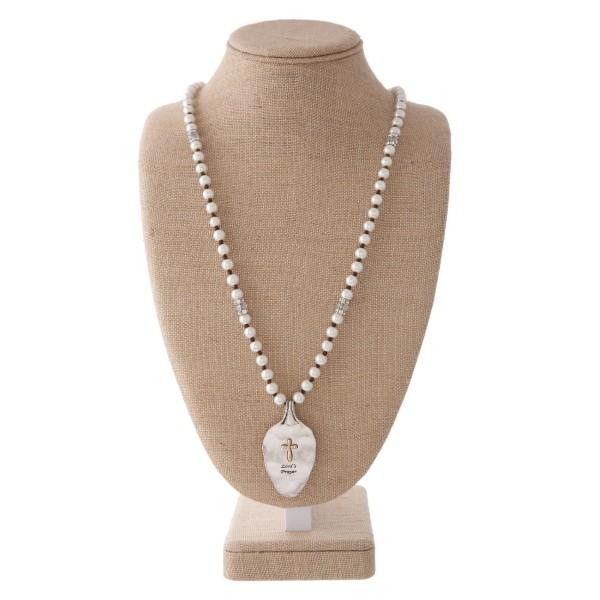 "Long pearl necklace with spoon pendant stamped with John 3:16. Approximately 30"" in length with a 2"" spoon."