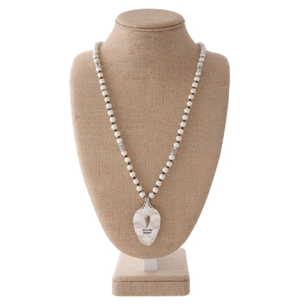 "Long pearl necklace with spoon pendant stamped with Serenity Prayer. Approximately 30"" in length with a 2"" spoon."