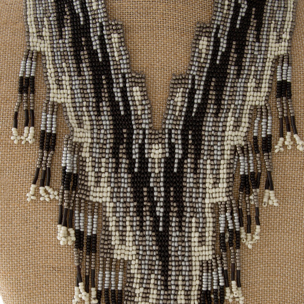 "Statement necklace with glass beads. Approximately 24"" in length."