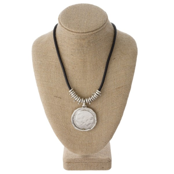 "Cord necklace with metal circle pendant. Approximately 20"" in length."