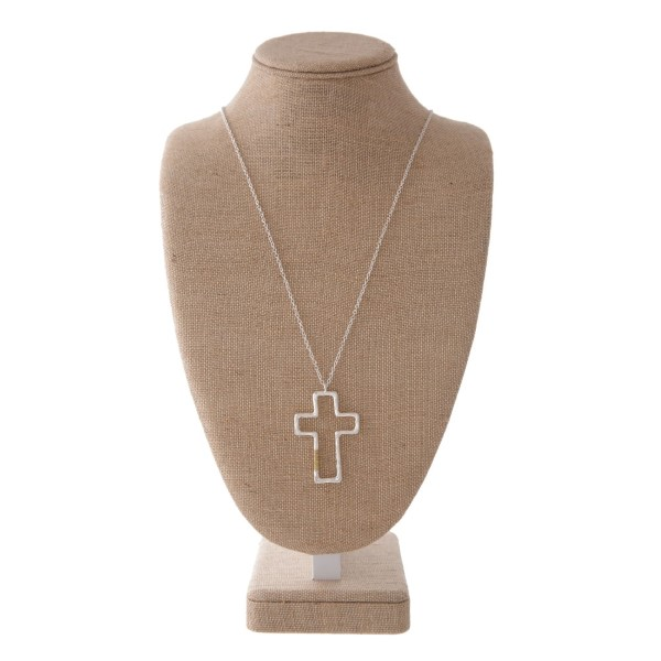 "Long metal necklace with cross pendant with wire wrap accent. Approximately 32"" with a 2"" pendant."