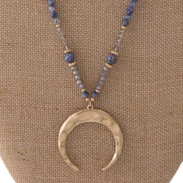 "Long necklace with natural stone beads and horn pendant. Approximately 30"" in length."