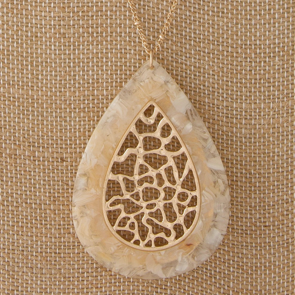 """Long gold tone necklace with acetate teardrop pendant. Approximately 32"""" in length."""