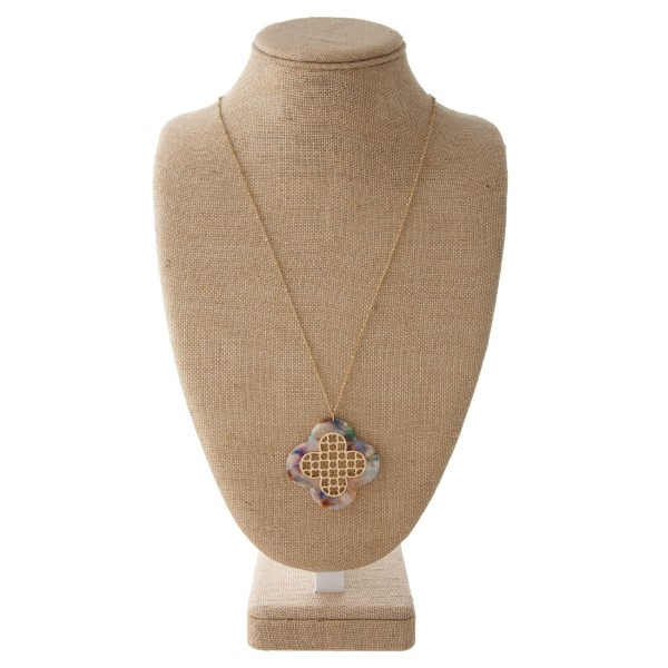 """Long gold tone necklace with acetate clover shape. Approximately 32"""" in length with a 2"""" pendant"""