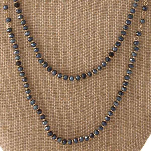 "Short silver tone necklace with wave detail. Approximately 18"" in length."