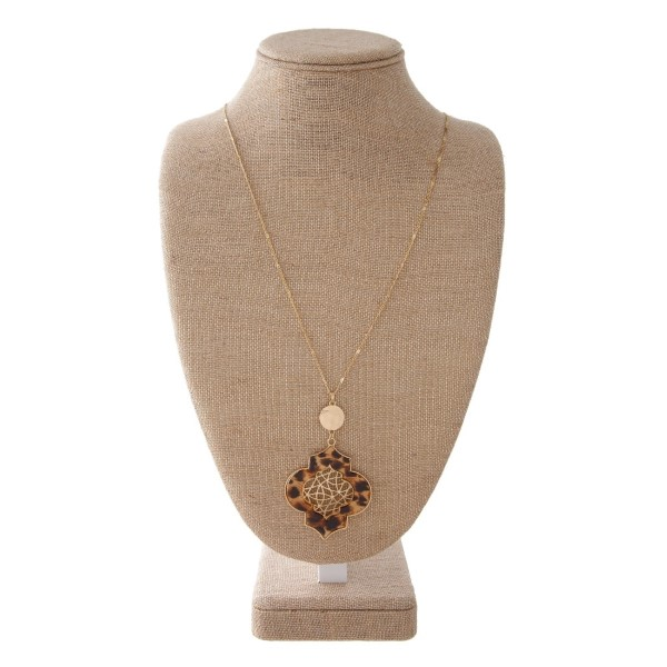 """Long necklace with filagree design. Approximately 32"""" in length with a 3"""" pendant."""