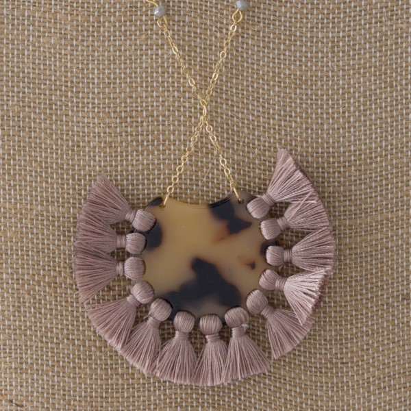 """Long necklace with acetate accent with soft thread tassels. Approximately 28"""" in length with a 3"""" pendant."""