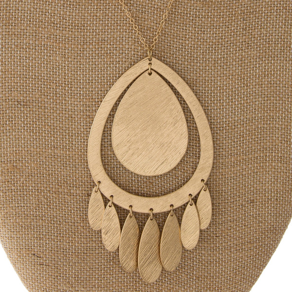 "Long metal necklace with tear drop pendant. Approximately 32"" in length with a 4"" pendant."