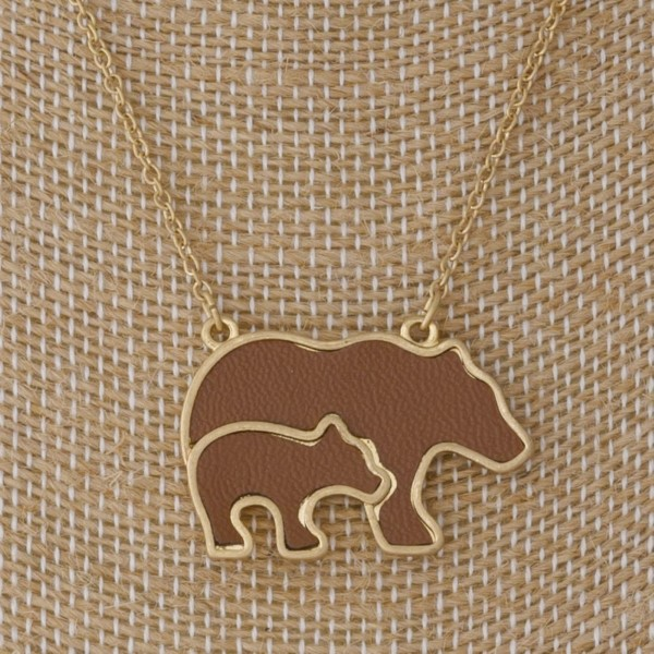 """Silver tone necklace with metal bear pendant. Approximately 18"""" in length."""