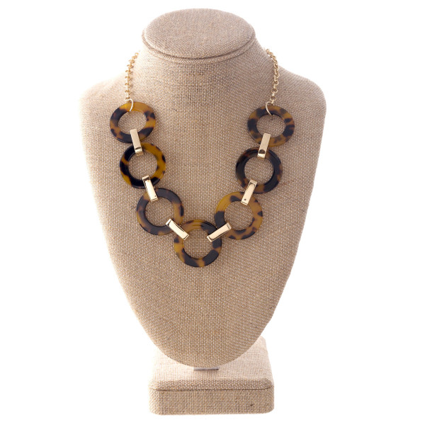 "Gold tone statement necklace with acetate detail. Approximately 20"" in length."
