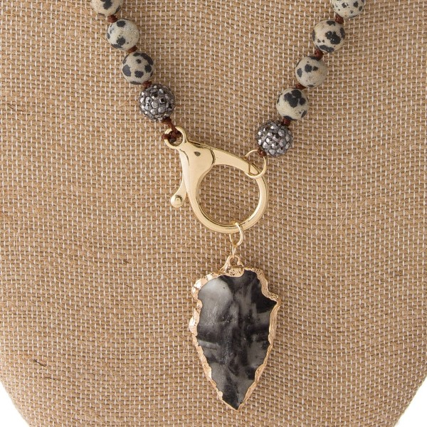 "Long necklace with natural stone beads and arrowhead pendant. Approximately 26"" in length with a 1.5"" pendant."