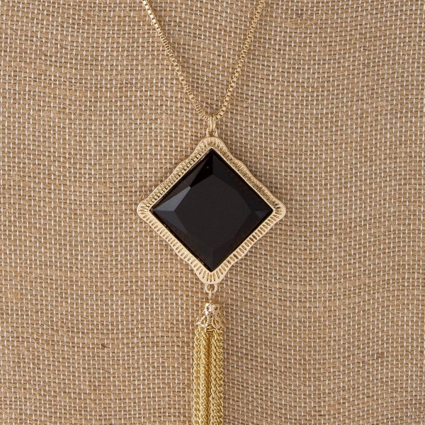 "Long gold tone necklace with square pendant and metal tassel. Approximately 32""in length with a 2.5"" tassel."