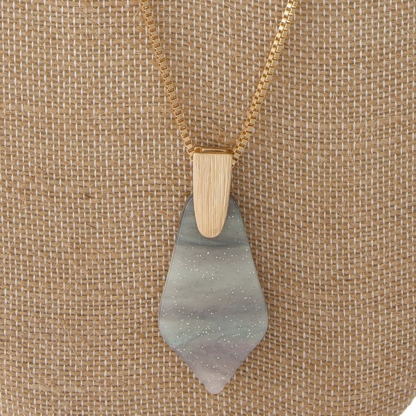 """Gold tone necklace with geometric acetate pendant. Approximately 30"""" in length with a 2"""" pendant."""