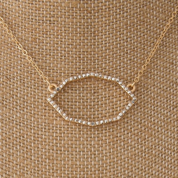 "Dainty metal necklace with oval focal. Approximately 18"" in length."