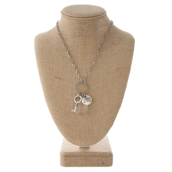 """Chain necklace with key charm, rhinestone detail and circle stamped with Always Believe. Approximately 16"""" in length."""