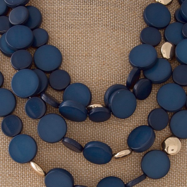 "Statement necklace with flat beads. Approximately 20"" in length."