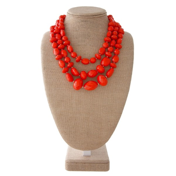 "Short statement necklace with faceted beads. Approximately 20"" in length."
