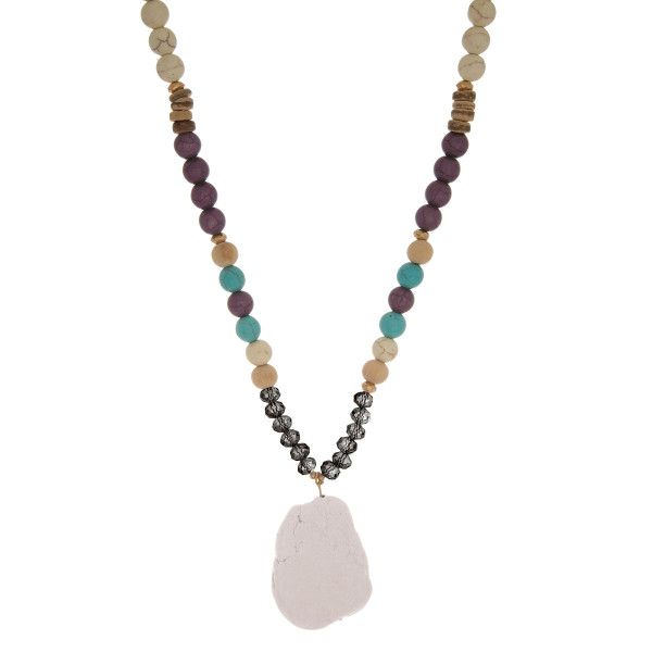 """Long, stone and faceted beaded necklace with natural stone pendant. Approximately 30"""""""