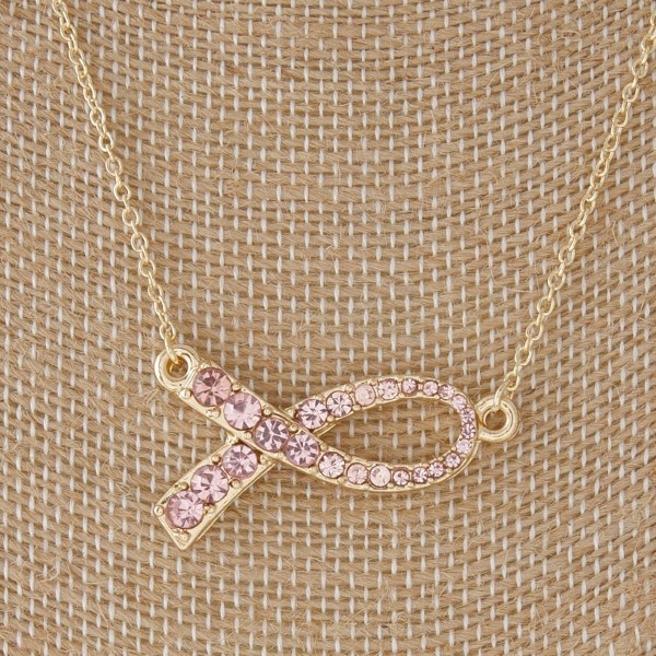 "Short necklace with a rhinestone breast cancer awareness ribbon. Approximately 16"" in length."