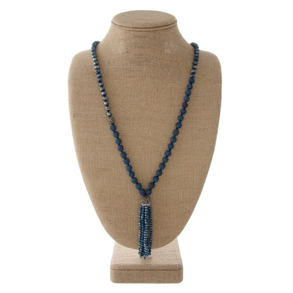"Long necklace with faceted beads and tassel. Approximately 31"" in length with a 3"" tassel."