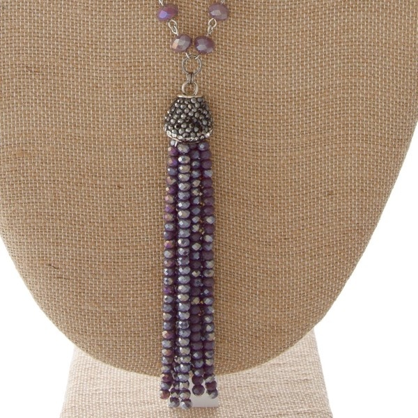 "Long necklace with faceted beads and tassel. Approximately 30"" in length with a 3.5"" tassel."