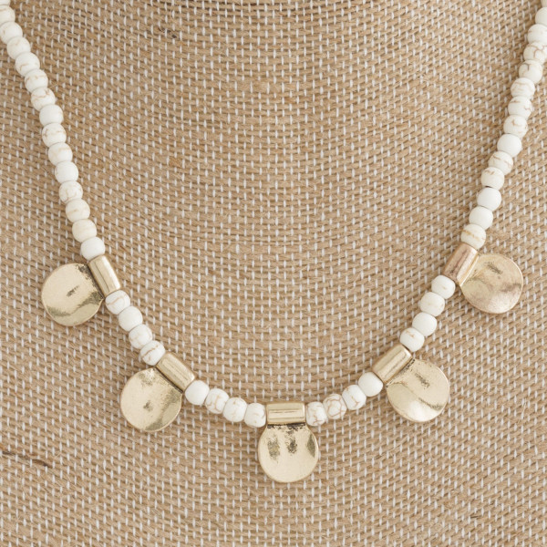 "Short natural stone necklace with gold charm. Approximately 18"" in length."