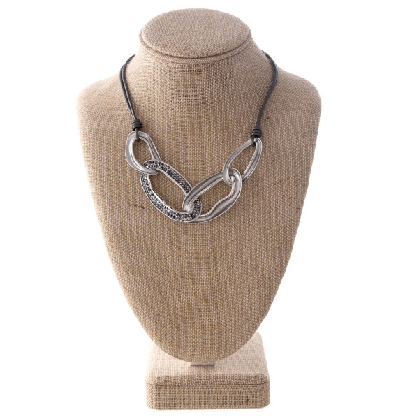 "Waxed cord necklace with linked metal ovals. Approximately 20"" in length."